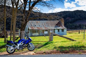 Motor cycle and old farm house